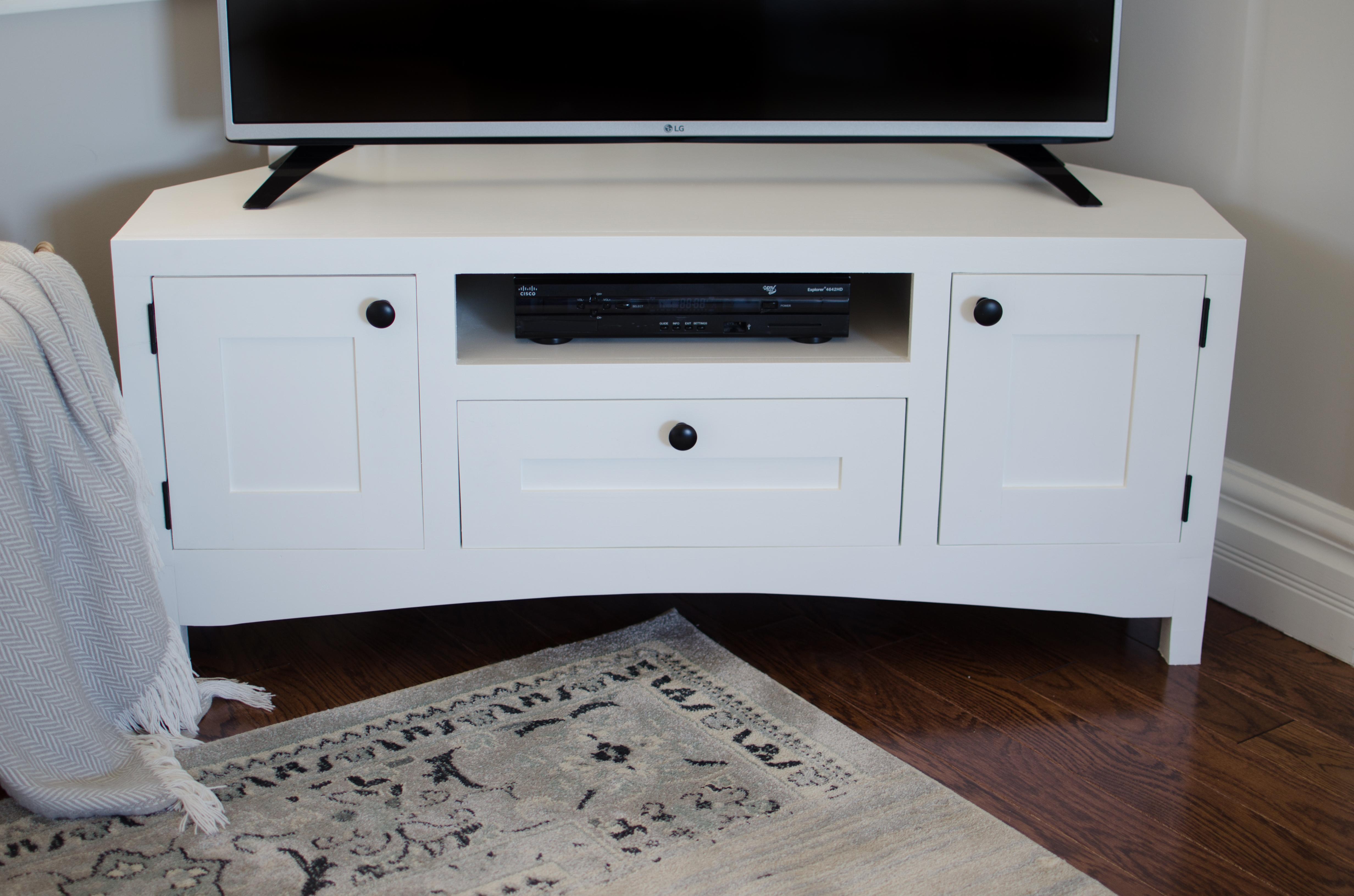 This Corner Tv Stand Allows You To Maximize The Space In Your Livingroom While Still Acting